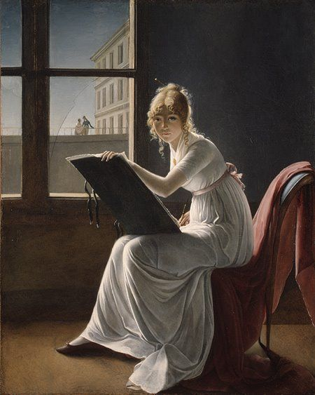 Une jeune femme qui peint